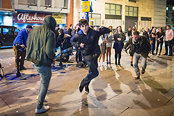© Licensed to London News Pictures . Manchester , UK . 05/04/2015 . People dance in the street to the sound of a beat boxing duo , on Withy Grove in Manchester City Centre . Revellers on a Saturday night out during the Easter Bank Holiday weekend . Photo credit : Joel Goodman/LNP