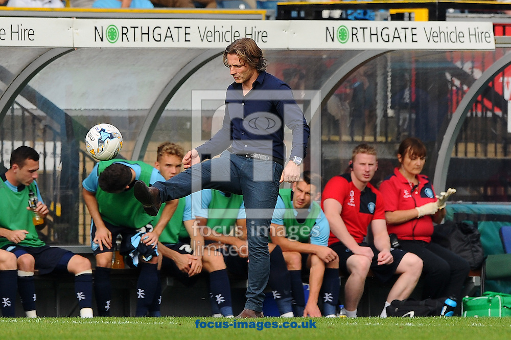 Manager of Wycombe Wanderers Gareth Ainsworth controls and puts the ball back into play during the Sky Bet League 2 match at Adams Park, High Wycombe<br /> Picture by Seb Daly/Focus Images Ltd +447738 614630<br /> 06/09/2014