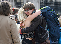 © Licensed to London News Pictures. 18/04/2019. London, UK. Campaigners arriving to join the protest embrace each other as Extinction Rebellion occupy Parliament Square for a fourth day. Protesters are demanding urgent government action on climate change. Photo credit: Ben Cawthra/LNP