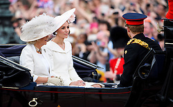 © Licensed to London News Pictures. 11/06/2016. London, UK. CAMILLA, DUCHESS OF CORNWALL, CATHERINE, DUCHESS OF CAMBRIDGE, and PRINCE HARRYin a horse drawn carriage during the Trooping The Colour ceremony in London. This years event is part of a weekend of celebration to mark the 90th birthday of Queen Elizabeth II, who is Britain's longest reigning monarch. Photo credit: Ben Cawthra/LNP