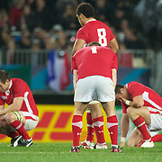 Welsh players react to their loss at the final whistle during the Wales V France Semi Final match at the IRB Rugby World Cup tournament, Eden Park, Auckland, New Zealand, 15th October 2011. Photo Tim Clayton...