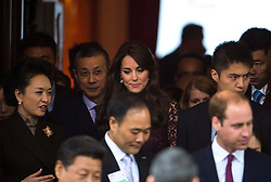 © Licensed to London News Pictures. 21/10/2015. London, UK. CATHERINE, Duchess of Cambridge (centre) leaving the event accompanied by PENG LIYUAN (left). CATHERINE, Duchess of Cambridge, and PRINCE WILLIAM, Duke of Cambridge accompanied Chinese president  XI JINPING and his wife PENG LIYUAN as they attend Creative Collaborations event at Lancaster House in London, as part of the Chinese state visit to the uk. The couples were shown a new Aston Martin DB10 from the Spectre James bond film and new London Bus and taxi transports.  Photo credit: Ben Cawthra/LNP