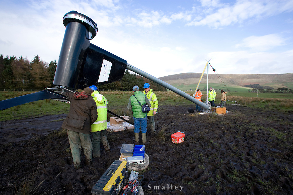 Team of workers preparing a small 6KW wind turbine for erection in Bowland.