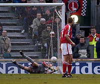 Photo. Glyn Thomas.<br /> Gillingham v Charlton. FA Cup Third Round.<br /> Priestfield Stadium. 03/01/2004.<br /> Tommy Johnson's first goal for Gillingham goes past a diving Dean Kiely (L) as Chris Perry looks on in horror.