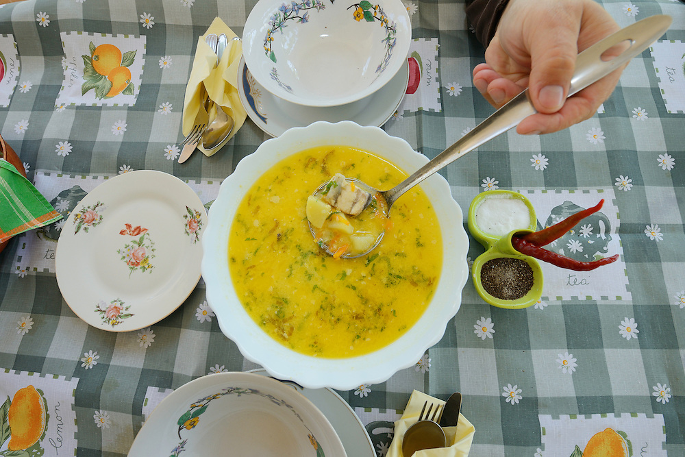 Fish soup serving at Mama Sika's guesthouse, Sfintu Gheorghe, Danube delta rewilding area, Romania