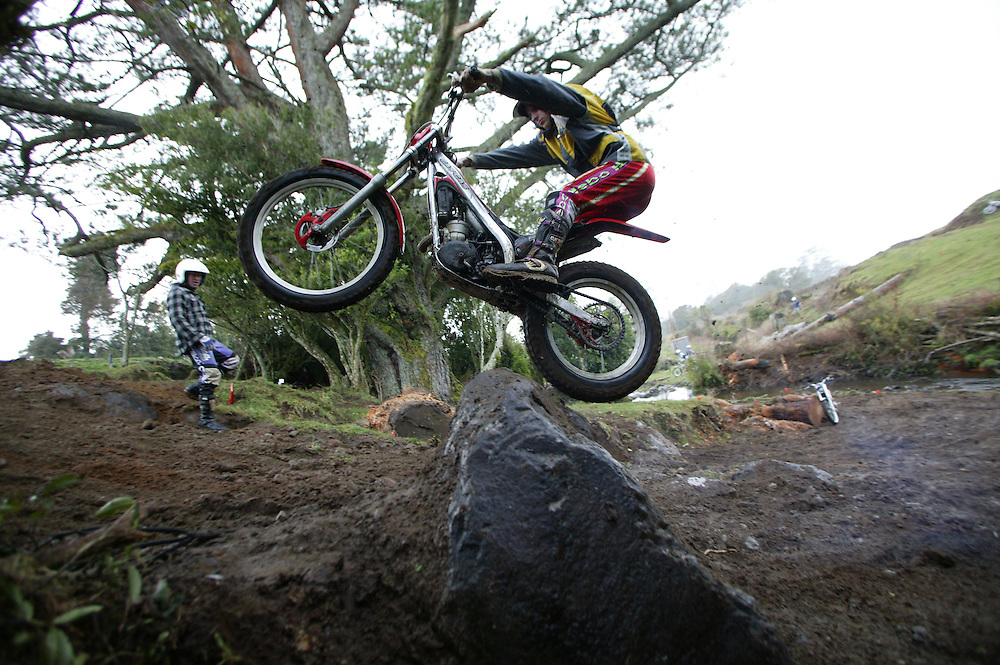 A young motor cross enthusiast negotiates a log jump on a Durham Road farm track in Egmont Village, New Zealand, May 29, 2006. Credit:SNPA / Rob Tucker