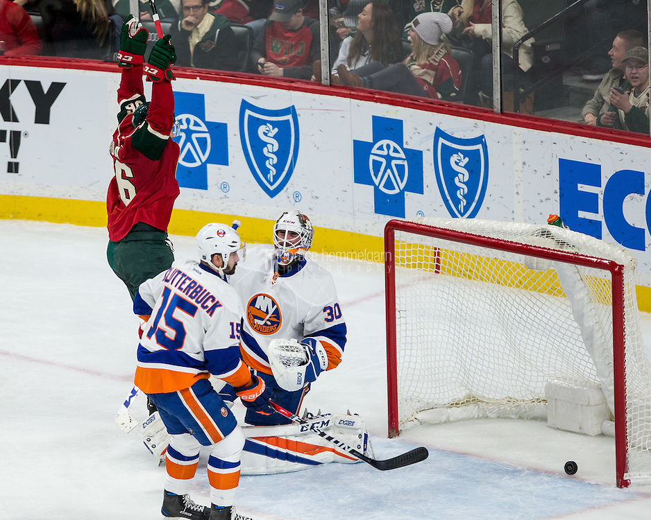 Dec 29, 2016; Saint Paul, MN, USA; Minnesota Wild forward Erik Haula (56) celebrates his goal ib New York Islanders goalie Jean-Francois Berube (30) during the third period at Xcel Energy Center. The Wild defeated the Islanders 6-4. Mandatory Credit: Brace Hemmelgarn-USA TODAY Sports