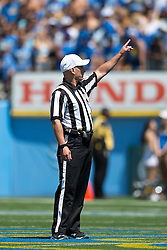 PASADENA, CA - SEPTEMBER 05:  College football referee Jerry Magallanes stands on the field during the first quarter between the UCLA Bruins and the Virginia Cavaliers at the Rose Bowl on September 5, 2015 in Pasadena, California.  The UCLA Bruins defeated the Virginia Cavaliers 34-16. (Photo by Jason O. Watson/Getty Images) *** Local Caption *** Jerry Magallanes