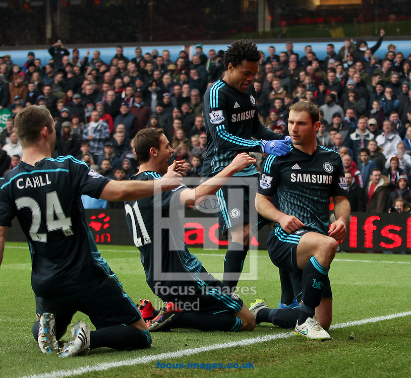 Branislav Ivanović (right) of Chelsea celebrates scoring his sides second goal with his team mates Gary Cahill, (left) Nemanja Matić (2nd left) and Lo&iuml;c R&eacute;my (2nd right) during the Barclays Premier League match at Villa Park, Birmingham<br /> Picture by Tom Smith/Focus Images Ltd 07545141164<br /> 07/02/2015