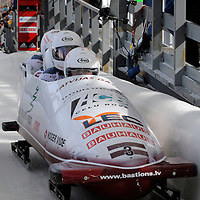 01 March 2009:   The Latvia 1 bobsled driven by Janis Minins with sidepushers Daumants Dreiskens and Oskars Melbardis, and brakeman Intars Dambis finish their 3rd place run at the 4-Man World Championships competition on March 1 at the Olympic Sports Complex in Lake Placid, NY bringing Latvia their first World Cup Medal ever.   The USA 1 bobsled driven by Steven Holcomb with sidepushers Justin Olsen and Steve Mesler, and brakeman Curtis Tomasevicz won the competition and the World Championship bringing the U.S. their first world championship since 1959 with a time of 3:36.61.
