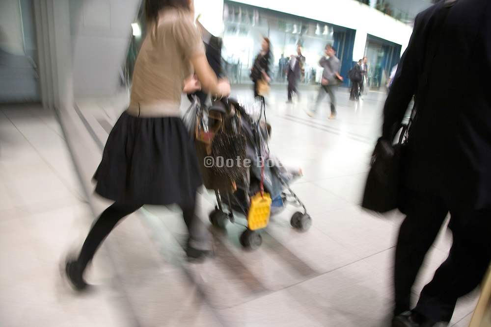businessman and young mother with child rushing forward