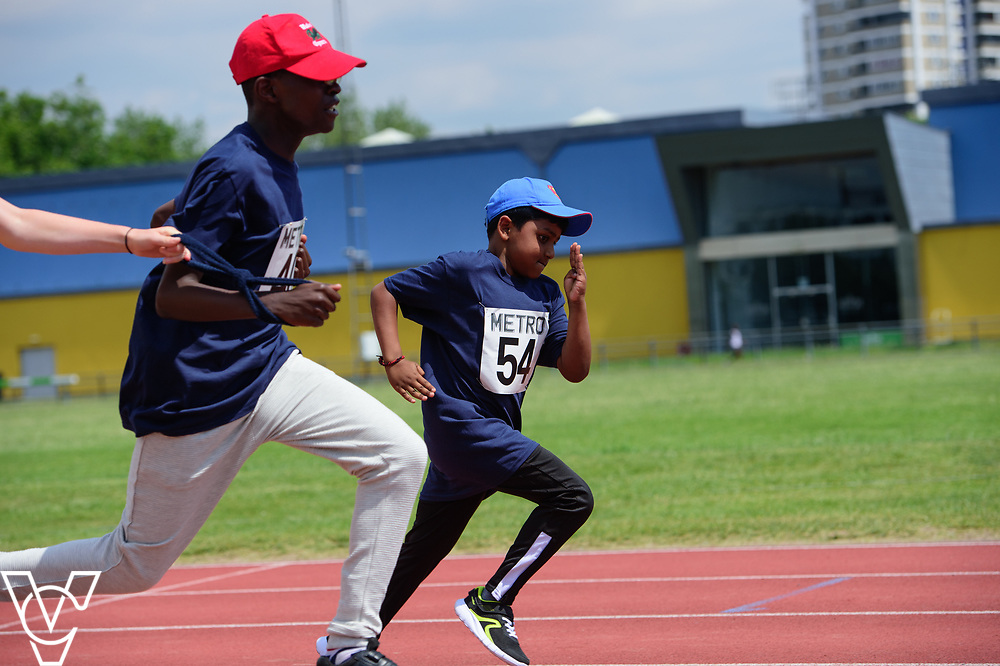 Metro Blind Sport's 2017 Athletics Open held at Mile End Stadium.  60m.  Ebenezer Adu-Poku with guide runner, left, and Ragul Sivaseelan<br /> <br /> Picture: Chris Vaughan Photography for Metro Blind Sport<br /> Date: June 17, 2017