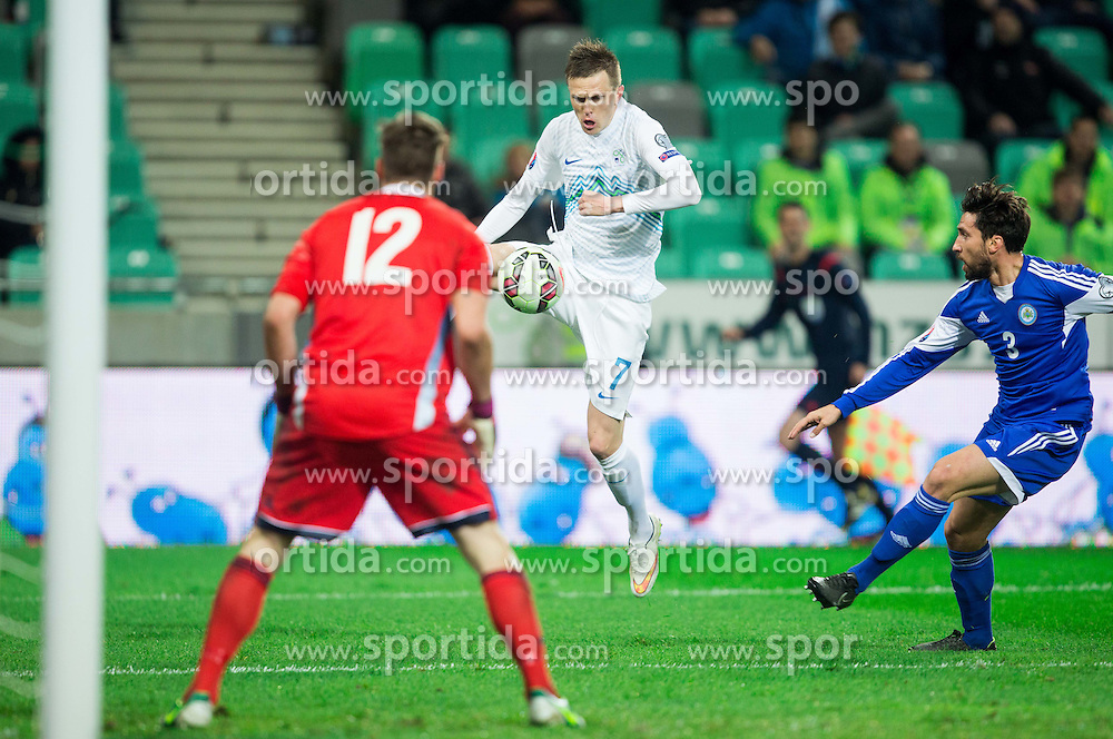 Elia Benedettini of San Marino and Mirko Palazzi of San Marino vs Josip Ilicic of Slovenia during football match between NationalTeams of Slovenia and San Marino in Round 5 of EURO 2016 Qualifications, on March 27, 2015 in SRC Stozice, Ljubljana, Slovenia. Photo by Vid Ponikvar / Sportida