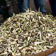 Garlic shoots at street market in Saigon