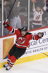 Mar 6; Newark, NJ, USA; New Jersey Devils right wing Steve Bernier (18) celebrates a goal by New Jersey Devils center Ryan Carter (20) during the third period of their game against New Jersey Devils at the Prudential Center. The Devils defeated the Rangers 4-1.