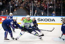 Pierre-Edouard Bellemare of France vs Jan Urbas of Slovenia during the 2017 IIHF Men's World Championship group B Ice hockey match between National Teams of France and Slovenia, on May 15, 2017 in AccorHotels Arena in Paris, France. Photo by Vid Ponikvar / Sportida
