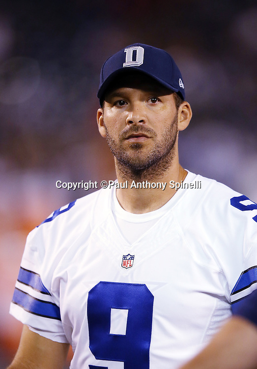 Dallas Cowboys quarterback Tony Romo (9) looks on from the sideline during the 2015 NFL preseason football game against the San Diego Chargers on Thursday, Aug. 13, 2015 in San Diego. The Chargers won the game 17-7. (©Paul Anthony Spinelli)