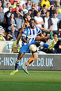 Gaëtan Bong challenged by James Henry during the Sky Bet Championship match between Wolverhampton Wanderers and Brighton and Hove Albion at Molineux, Wolverhampton, England on 19 September 2015. Photo by Alan Franklin.