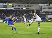 Jordan Amavi of Aston Villa clears the ball past Joe Ralls of Cardiff City during the EFL Sky Bet Championship match between Cardiff City and Aston Villa at the Cardiff City Stadium, Cardiff, Wales on 2 January 2017. Photo by Andrew Lewis.