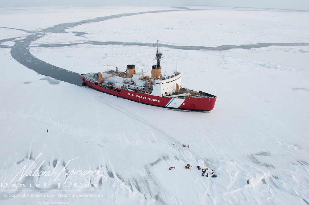 The icebreaker Polar Sea sits in the arctic pack ice of the Beaufort Sea while dive and ice coring teams collect samples. Arctic Ocean