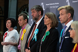© Licensed to London News Pictures . 26/05/2019. Manchester, UK.  L-R winners THERESA GRIFFIN (Labour Party), CHRIS DAVIES (Liberal Democrats), HENRIK NIELSEN (Brexit Party), GINA DOWDING (Green Party), DAVID BULL (Brexit Party), JANE BROPHY (Liberal Democrats). The count for seats in the constituency of North West England in the European Parliamentary election , at Manchester Central convention centre . Photo credit: Joel Goodman/LNP