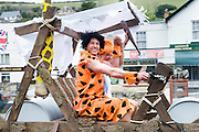 Mar 31, 2010 - Devon, United Kingdom -  *EXCLUSIVE* <br /> <br /> I Yabba-Dabba-Do! Couple Tie The Knot In Flintstones-Themed Wedding<br /> <br /> Most brides choose to wear a white wedding dress as they walk down the aisle. But Gayle Watson had one unusual accessory when she tied the knot yesterday - a bright orange wig. Because Gayle, 29, and fiancé Ed Robinson, 34, are such huge Flintstones fans that they decided to dress as Fred and Wilma for their big day. But it wasn't just the bride and groom that got into the prehistoric spirit by dressing up for the Flintstones-themed wedding. While the best man and maid of honour were transformed into Barney and Betty Rubble, the page boy and girl dressed as Bam Bam and Pebbles for the ceremony at the Landmark Theatre in Ilfracombe, Devon. And over 100 guests joined in the fun by dressing in caveman outfits suitable for the streets of Bedrock, where the famous TV cartoon series was set. The couple even had a Flinstones car created especially for the occasion. Ed, who lives with Gayle in the nearby town of Combe Martin, said: 'It was a fantastic day and everyone really enjoyed it. We built the Flintstones car and had a 20-ft dinosaur to set the scene. 'Everyone really got into it as cave men and women.  We got married on the stage of the Landmark Theatre which we plastered to look like a cave and it really looked like something from the Flintstones! 'We were inspired by the cave and rock setting of Combe Martin so decided to do something a bit different as we didn't just want a normal traditional wedding.   Photo Shows: Cartoon nuptuals: Ed Robinson and Gayle Watson dressed up as Fred and Wilma Flintstone for their wedding<br /> (Credit Image: © Guy Harrop/Exclusivepix)