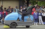 Flamboyant local figure and Newark Mayor spontaneously jumps on a street sweeper during the African American Heritage Parade. He would be convicted on corruption charges years later.