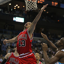 Jan 29, 2010; New Orleans, LA, USA; Chicago Bulls center Joakim Noah (13) and New Orleans Hornets center Emeka Okafor (50) go for a rebound during the second half at the New Orleans Arena. The Bulls defeated the Hornets 108-106 in overtime. Mandatory Credit: Derick E. Hingle-US PRESSWIRE