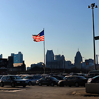 American flag waves in front of the Detroit skyline. Melanie Maxwell