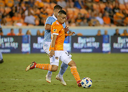 August 4, 2018 - Houston, TX, U.S. - HOUSTON, TX - AUGUST 04:  Houston Dynamo midfielder Darwin Ceren (24) prepares to pass the ball during the soccer match between Sporting Kansas City and Houston Dynamo on August 4, 2018 at BBVA Compass Stadium in Houston, Texas.  (Photo by Leslie Plaza Johnson/Icon Sportswire) (Credit Image: © Leslie Plaza Johnson/Icon SMI via ZUMA Press)