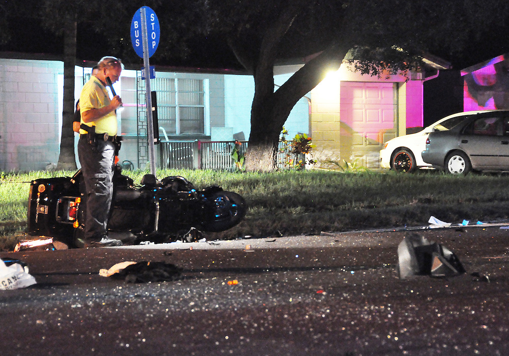 Andrew Knapp, FLORIDA TODAY -- July 22, 2011 -- Officer Jim O'Byrne, a traffic homicide investigator with the Melbourne Police Department, looks over the scene of a crash in which a motorcyclist was struck by a car and critically injured Friday night at Parkway Drive and Stewart Road.