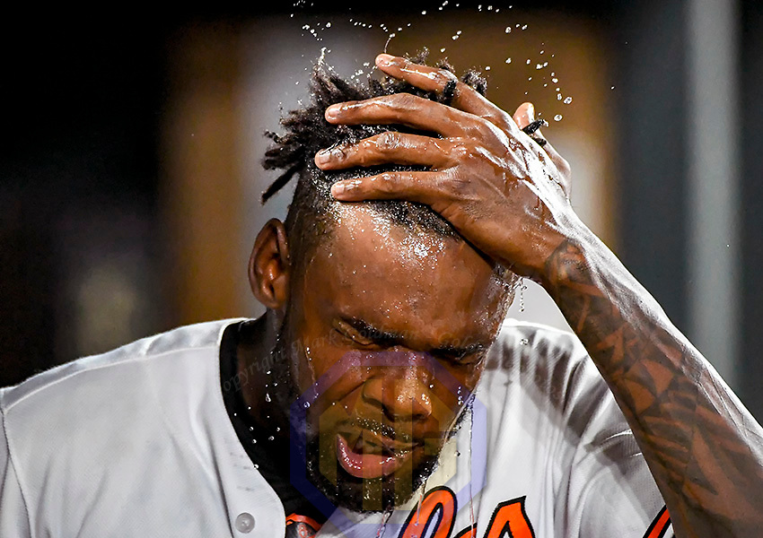 BALTIMORE, MD - JULY 20:  Baltimore Orioles relief pitcher Miguel Castro (50) cools off in the dugout after pitching during an MLB game between the Texas Rangers and the Baltimore Orioles on July 20, 2017, at Orioles Park at Camden Yards in Baltimore, MD. The Baltimore Orioles defeated the Texas Rangers, 9-7.  (Photo by Mark Goldman/Icon Sportswire)
