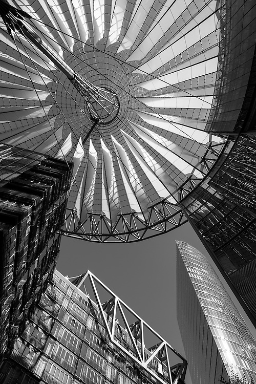 Modern architecture of Sony Centre at Potsdamer Platz in Berlin. Daylight, black and white. Portrait format.
