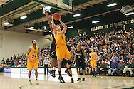 Catamounts forward Zach McRoberts (1) leaps for a lay up during the men's basketball game between the Binghamton Bearcats and the Vermont Catamounts at Patrick Gym on Monday night January 19, 2015 in Burlington, Vermont. (BRIAN JENKINS, for the Free Press)