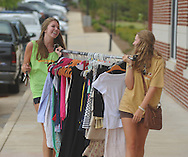 University of Mississippi freshman student Abby Posey, left, and senior Katie Smith move a rack of clothes into a dorm in Oxford, Miss. on Wednesday, August 17, 2011. Classes for the fall semester begin Monday, August 22, 2011. (AP Photo/Oxford Eagle, Bruce Newman)
