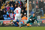 Liverpool goalkeeper Simon Mignolet (22)  saves from Crystal Palace midfielder Yannick Bolasie  during the Barclays Premier League match between Crystal Palace and Liverpool at Selhurst Park, London, England on 6 March 2016. Photo by Simon Davies.