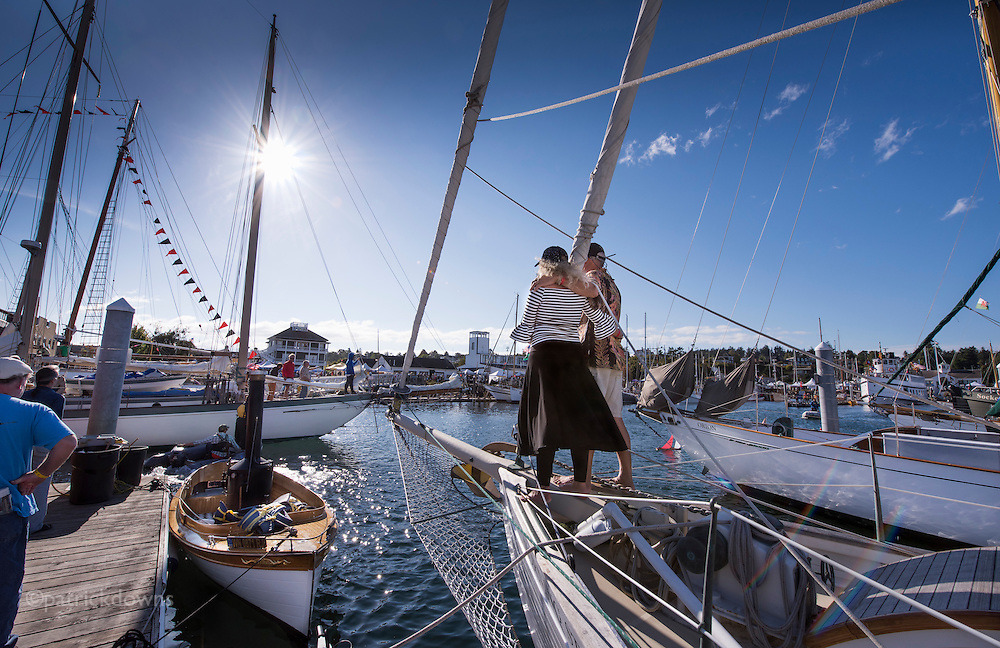 Wooden Boat Festival: A couple aboard the MorningStar watch as schooner Martha comes back in after the schooner race at the festival.