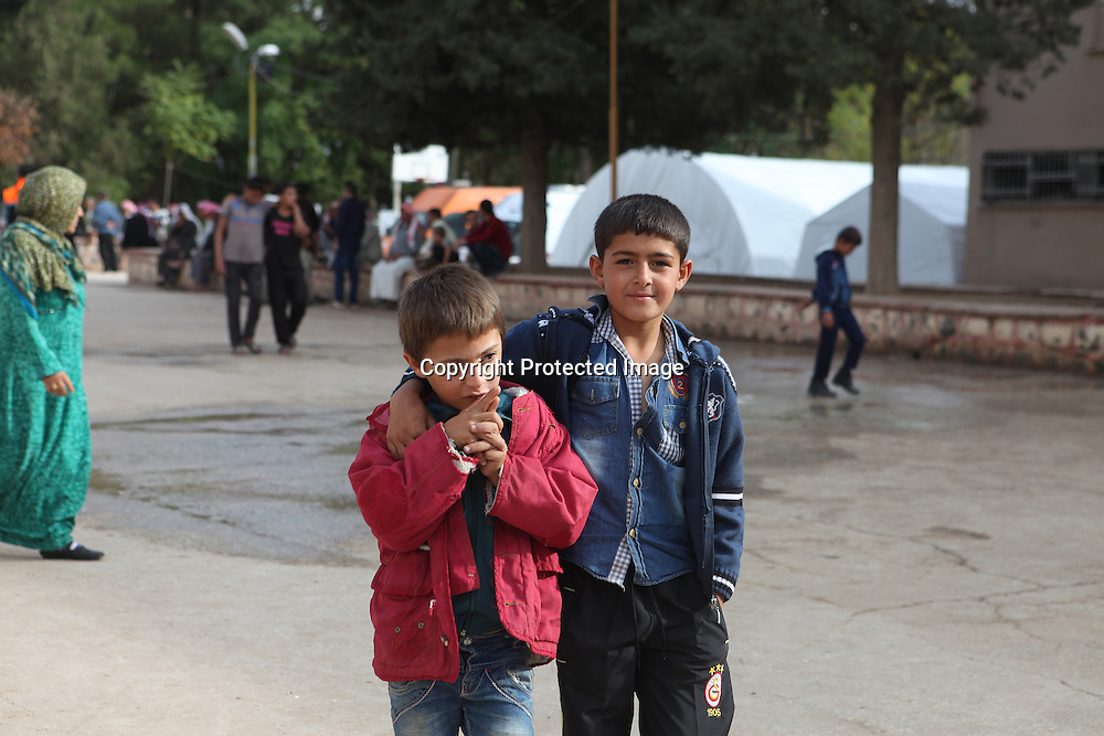 Syrian Kurdish boys became refugees after ISIS invaded they home town Kobani in Syria and now are living in a school complex located in the boarder town of Suruc, Turkey.