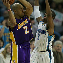 23 December 2008:  New Orleans Hornets guard Chris Paul (3) defends Los Angeles Lakers guard Derek Fisher (2) during a 100-87 loss by the New Orleans Hornets to the Los Angeles Lakers at the New Orleans Arena in New Orleans, LA. .