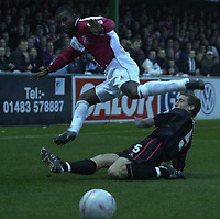 Picture: Raymond Field<br /><br /><br />Woking F.C v Kidderminster Harriers FA second round<br /><br />06/12/2003<br /><br />Craig Hinton trys to keep Raphael Nade back