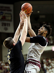 Texas A&M's Tonny Trocha-Morelos (10) makes a shot over Vanderbilt's Luke Kornet (3) during the first half of an NCAA college basketball game, Saturday, March 5, 2016, in College Station, Texas. Texas A&M won 76-67. (AP Photo/Sam Craft)