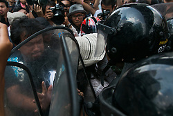 © Licensed to London News Pictures. 24/05/2014. Anti-Coup protestors clash with riot police following a Anti-Coup protest in Bangkok Thailand. The Royal Thai army announced a Military coup and have imposed a 10pm curfew.  Photo credit : Asanka Brendon Ratnayake/LNP