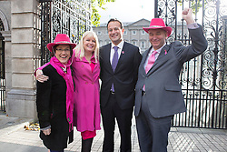 Repro Free: 15/10/2014 <br /> Kathleen O'Meara, head of advocacy and communications and John McCormack CEO, Irish Cancer Society are pictured with Mary Mitchell O'Connor T.D. and the Minister for Health Leo Varadkar T.D. as staff and supporters of the Irish Cancer Society gathered outside Leinster House to welcome the Government&rsquo;s decision to make the necessary investment to ensure BreastCheck will be extended to women aged between 65-69 years of age. The extension of screening to this age group will save a minimum of 87 lives per year.<br /> The Society has been campaigning for women in the 65-69 age group to be screened for breast cancer since 2011. One in ten of all breast cancers occur in women of this age.  The International Agency for Research on Cancer (IARC) says that quality screening mammography carried out every two years in women who are 50-69 years of age should reduce their risk of dying from breast cancer by about 35%. Picture Andres Poveda
