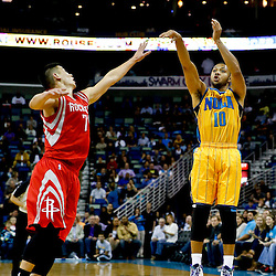 Jan 25, 2013; New Orleans, LA, USA; New Orleans Hornets shooting guard Eric Gordon (10) shoots over Houston Rockets point guard Jeremy Lin (7) during the first quarter of a game at the New Orleans Arena. Mandatory Credit: Derick E. Hingle-USA TODAY Sports
