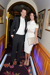 LOUIE EVANS and his wife CHERIE at the launch of Bluehouse, Samsung's Exclusive New members Club held at Annabel's, 44 Berkeley Square, London on 1st July 2013.