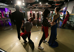 Studio assistants Alex Cameron and Olivia Steen move apart the wax figures of Brad Pitt and Angelina Jolie at Madame Tussauds London following the news of their divorce.