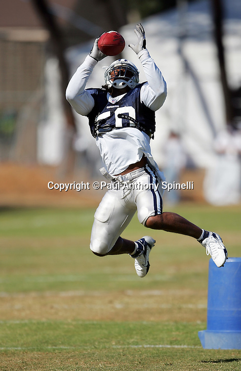 OXNARD, CA - AUGUST 9:  Linebacker Akin Ayodele #50 (a 2006 free agent acquisition) of the Dallas Cowboys catches a pass during the Dallas Cowboys training camp on August 9, 2006 in Oxnard, California. ©Paul Anthony Spinelli *** Local Caption *** Akin Ayodele