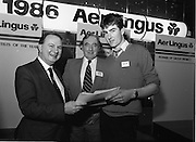 10/01/1986.01/10/1986.10th January 1986.The Aer Lingus Young Scientist of the Year Exhibition at the RDS, Dublin...Picture shows Con Power, (left) Director, Economic Policy, Confederation of Irish Industries, presenting the CII Award for the Physical, Mathematical and Applied Sciences, Intermediate Pupils, to Brian Gribben of St. Olcan's Secondary School, Randlestown, Co. Antrim. Also pictured is Niall G. Weldon, Chairman of the Panel of Judges. Brian's winning project was entitled 'Computer Controlled Pig Feed Unit'. .