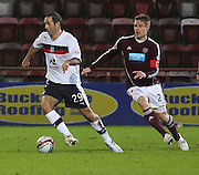 Dundee's Gary Harkins  and Hearts' Marius Zaliukas  - Hearts v Dundee in the Clydesdale Bank, Scottish Premier League at Tynecastle.. - © David Young - www.davidyoungphoto.co.uk - email: davidyoungphoto@gmail.com