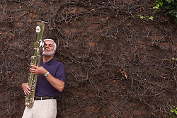 Tom Winthorpe playing his ophicleide, a rare instrument, which he will be playing during a performance at the proms. Tom at his home in Ware, Hertfordshire. July 11, 2000..Photo by Andrew Parsons/i-Images..